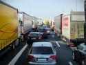 Korek, ciężarówki, TIRy, samochody osobowe